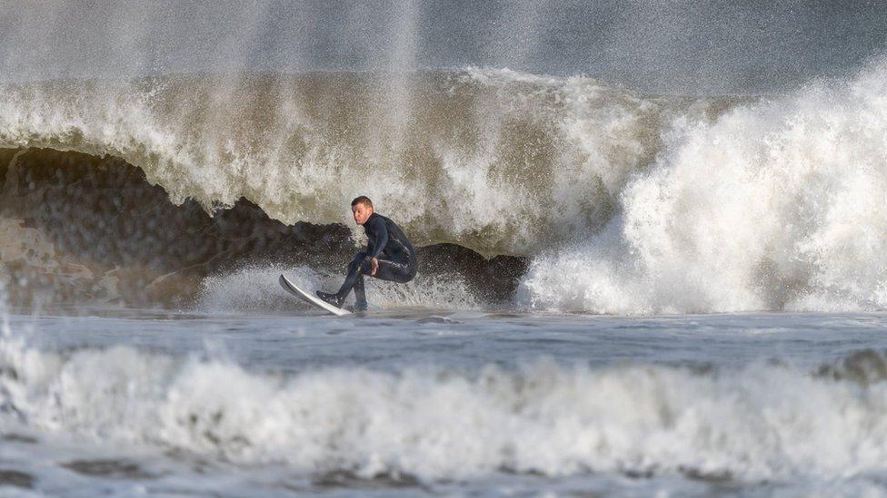 Surfers took advantage of the huge swells on the Irish coastline