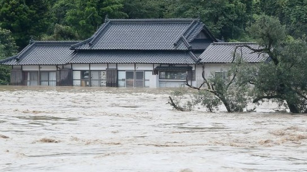 The Kuma river bursts its banks in Yatsushiro in Kumamoto prefecture
