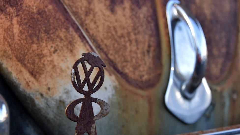 VW logo on rusty Beetle