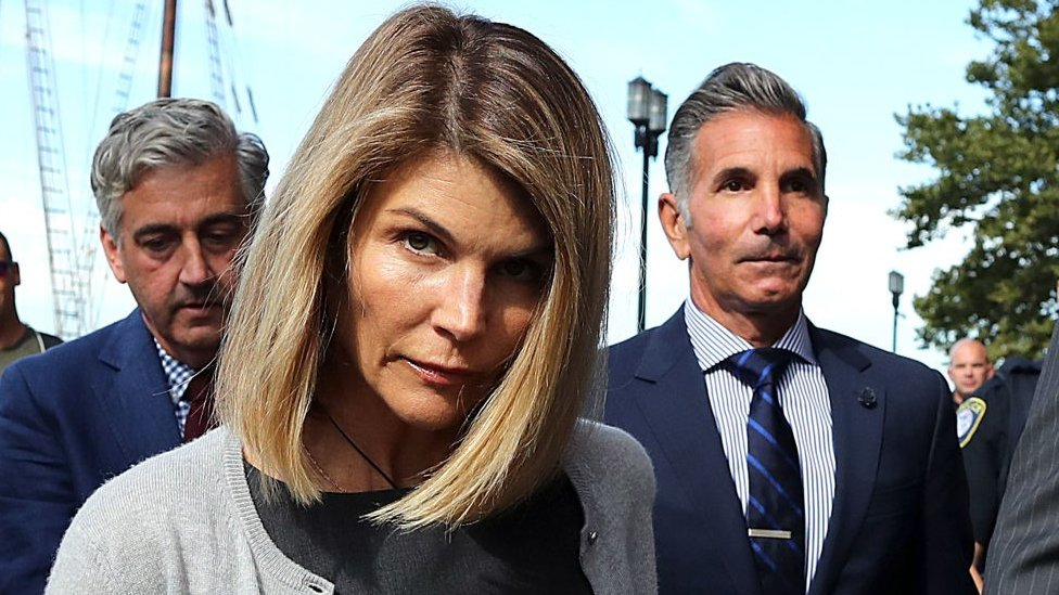 Lori Loughlin and her husband Mossimo Giannulli, right, leave the John Joseph Moakley United States Courthouse in Boston on Aug. 27, 2019