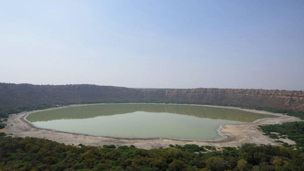 Panoramic view of the Lonar Crater and its saline lake in India's Maharashtra state.