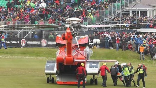 An air ambulance transfers an injured woman to hospital during the 2015 North West 200.