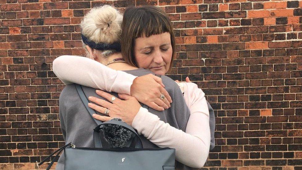Rachel hugs her eldest daughter
