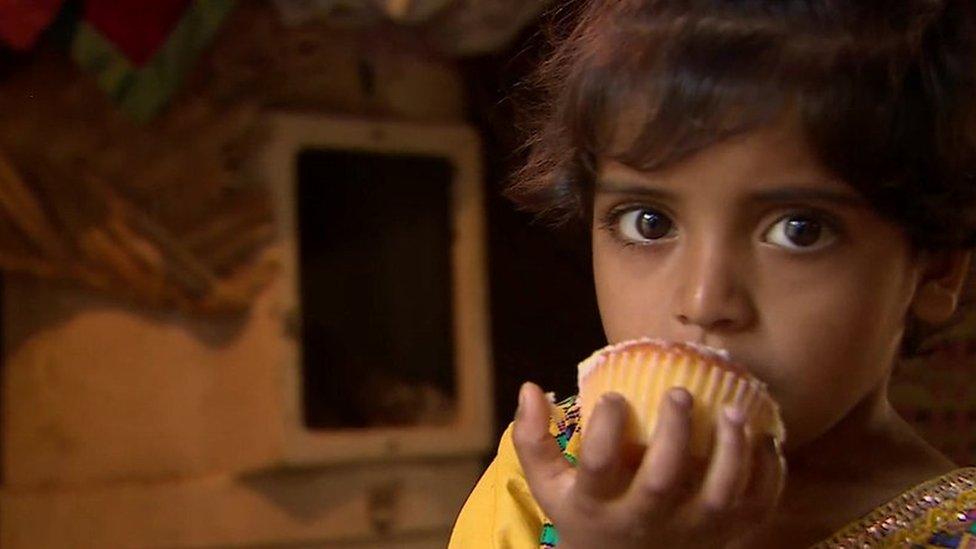 Young girl eating cake