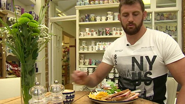 England rugby player Tom Wood sitting down with a full plate of food in front of him