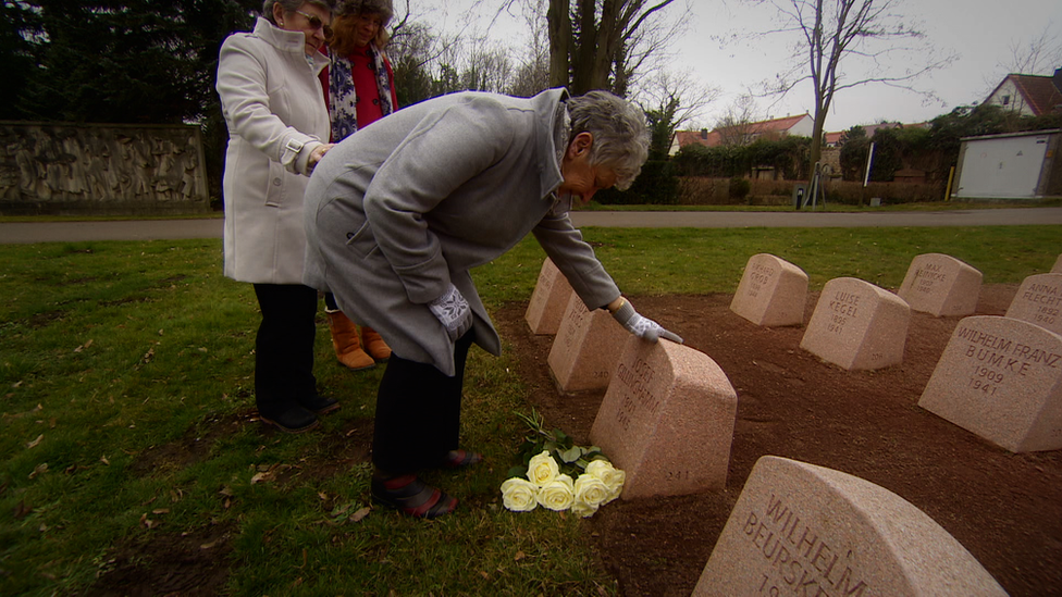 Mrs Harris at father's graveside