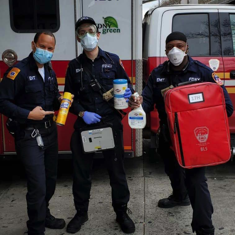 NYC paramedics with cleaning equipment