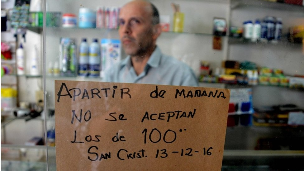 Sign in a shop in the border town of San Cristobal in Venezuela warns that 100-bolivar notes will not be accepted from Tuesday