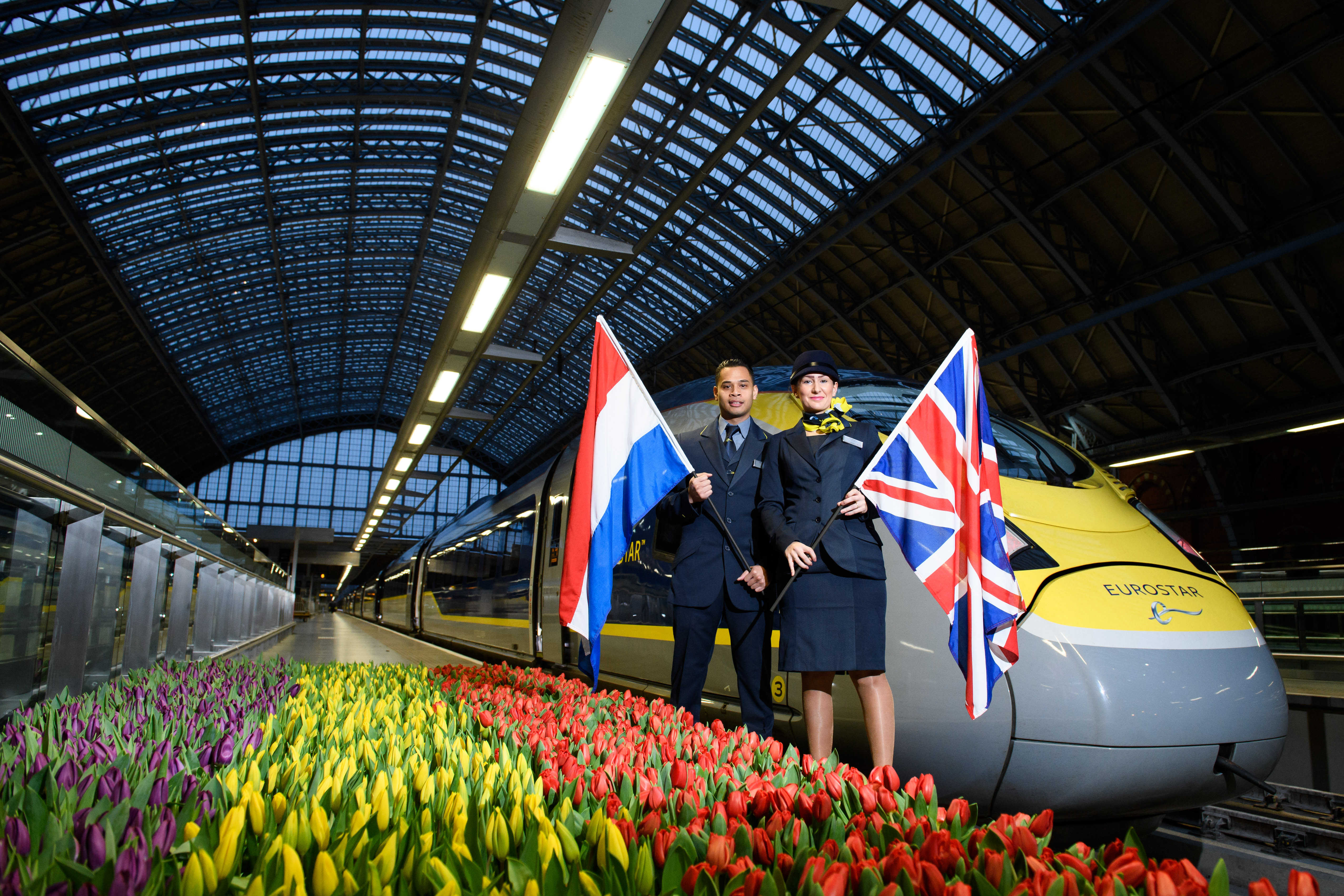 Eurostar staff stand next to a train as the first service set off from St Pancras
