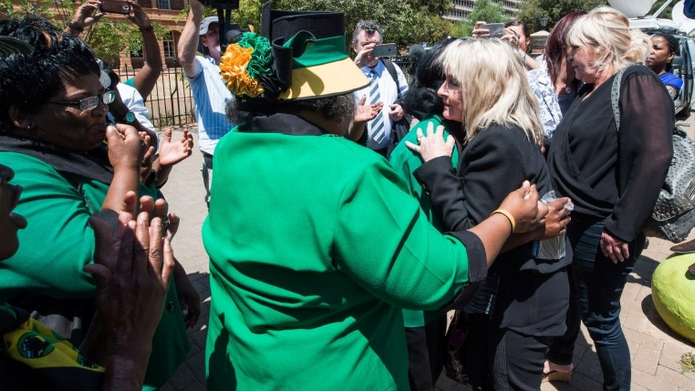 June Steenkamp (2nd from R), the mother of Reeve Steenkamp, is embraced by African National Congress Women League