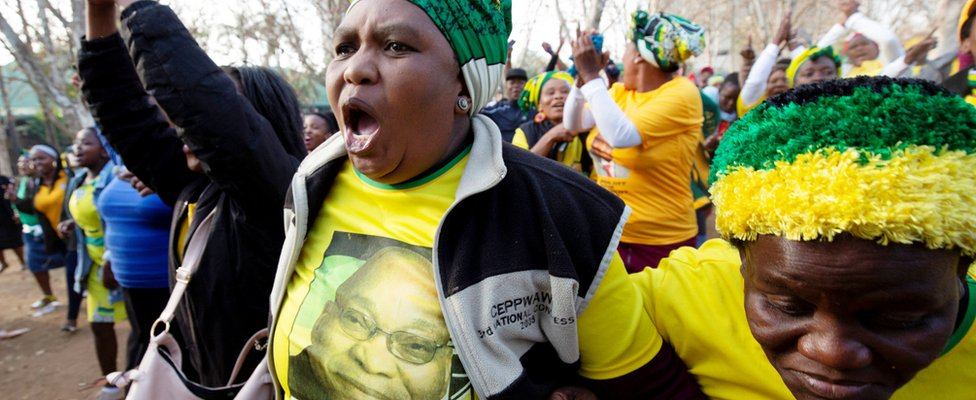 Supporter of Jacob Zuma raising her fist