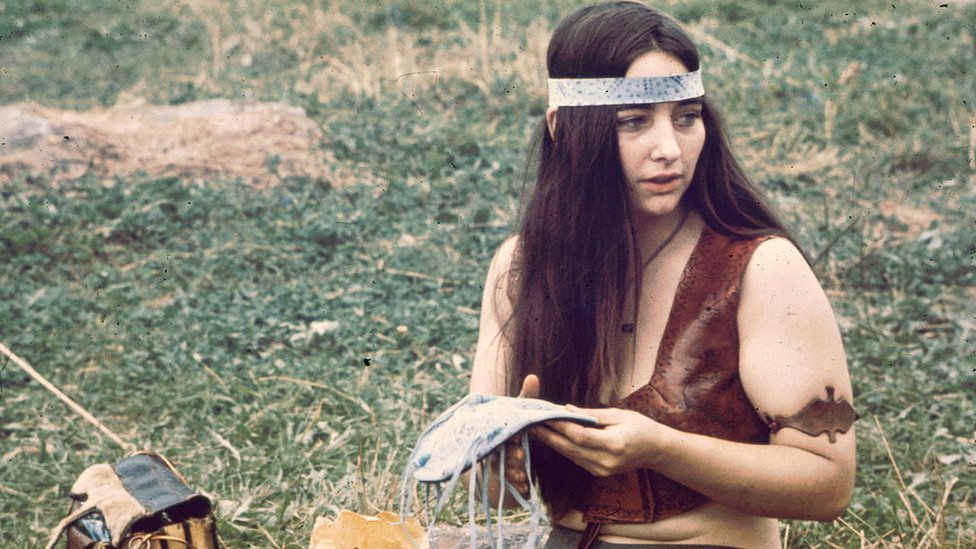 """A woman near the """"Free Stage"""" at the Woodstock Music and Arts Fair, Bethel, New York, August 1969"""