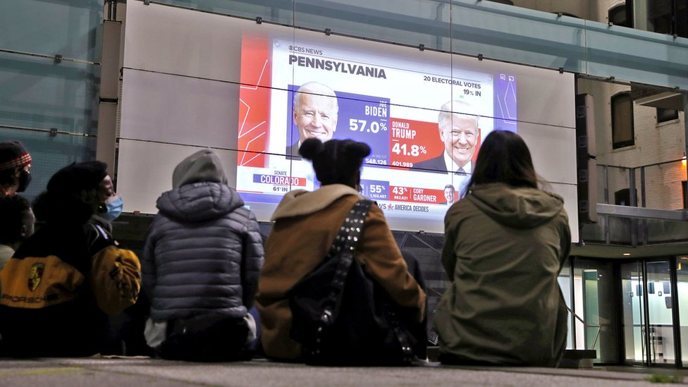 ReutersPeople watch early results on a large outdoor screen