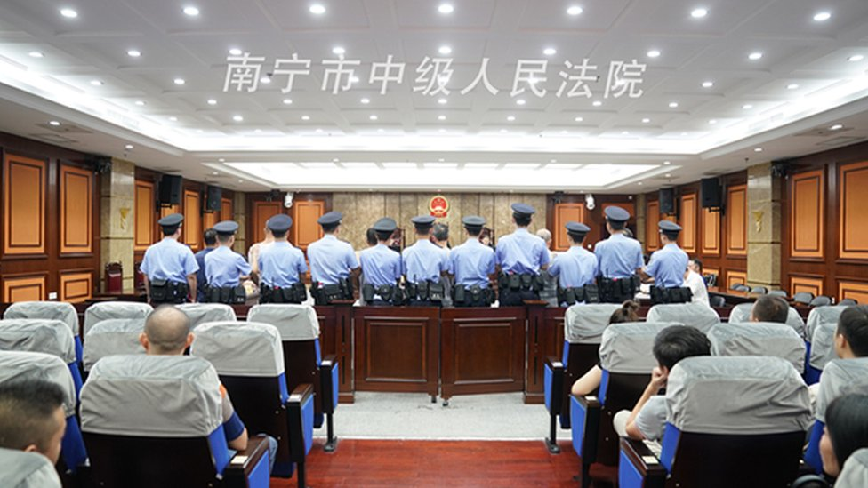 Police officers in court in Nanning