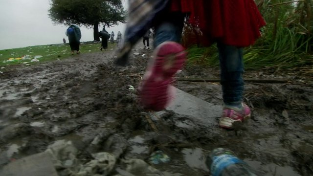 Migrant walking in mud in Macedonia