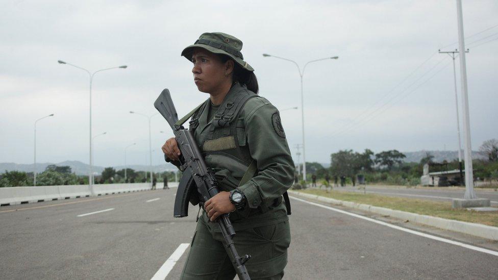 A Venezuelan army member stands guard at the entrance of the Tienditas cross-border bridge between Colombia and Venezuela in Tienditas, Venezuela, February 8, 2019.