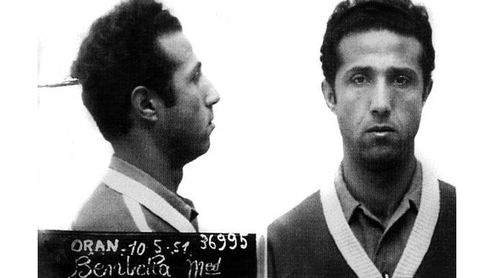 تم اعتقاله عام 1950 بعد غارة على مركز البريد الرئيسي في وهران لتمويل أنشطته الثورية