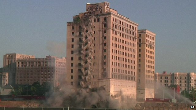 """A vacant former hotel in Detroit starts to collapse as it is demolished by """"implosion"""" to make way for a new hockey arena"""