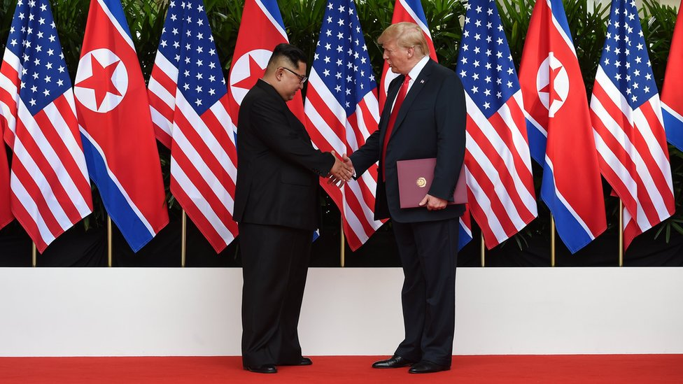 Kim Jong-un and Donald Trump shaking hands
