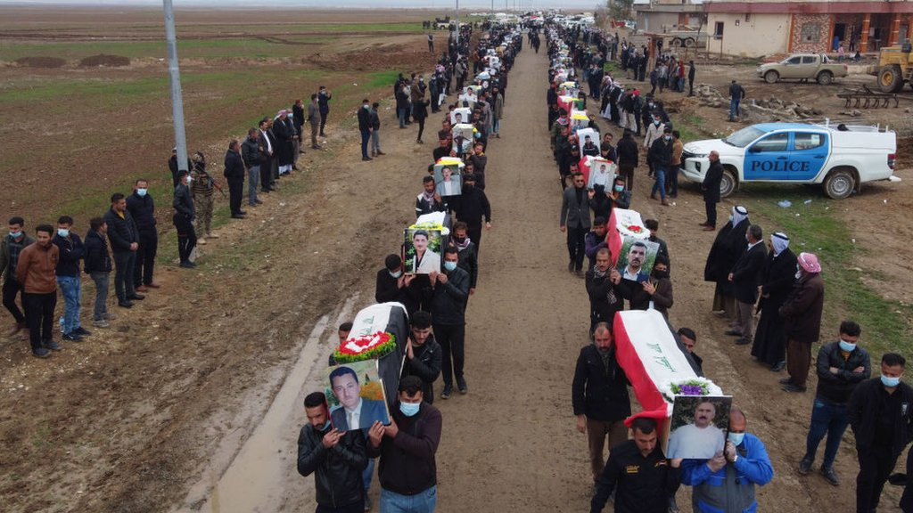 Procession of coffins carried for the mass funeral in Kocho on 6 February 2021