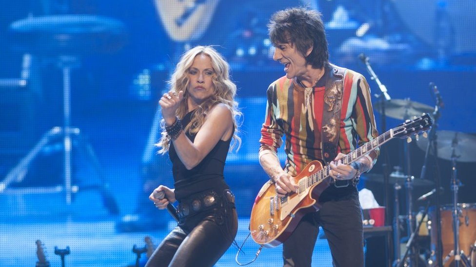 Sheryl Crow and Ronnie Wood on stage in 2013