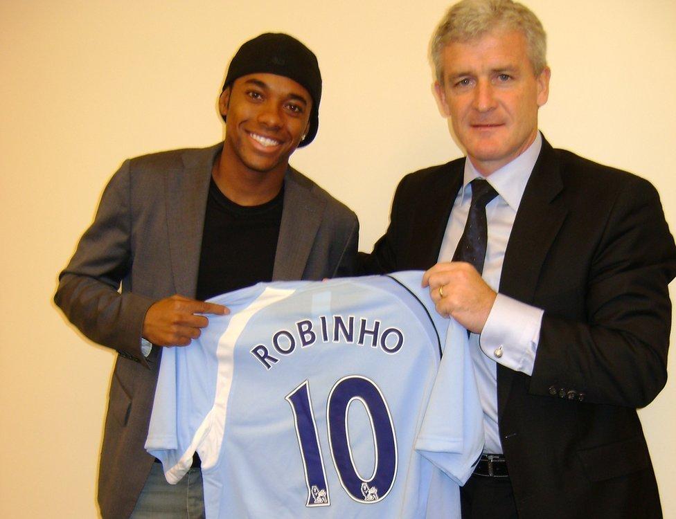 Robinho and Mark Hughes holding a Manchester City shirt