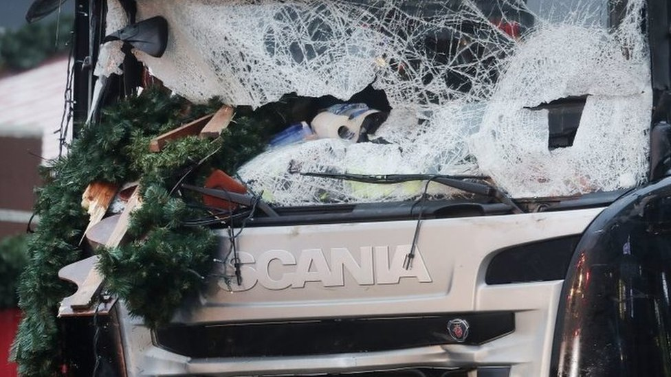 The smashed window of the cabin of a truck which ran into a crowded Christmas market Monday evening killing several people Monday evening is seen in Berlin, Germany, Tuesday, Dec. 20, 2016.