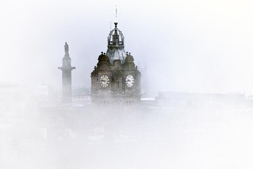 Fog surrounds the Balmoral Clock in Edinburgh