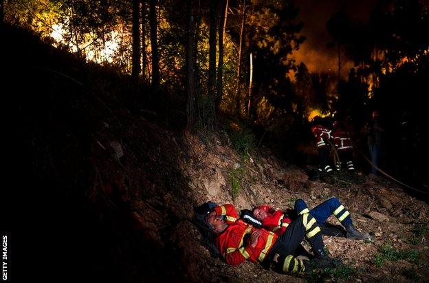Firefighters rest during the wildfires of central Portugal in June 2017