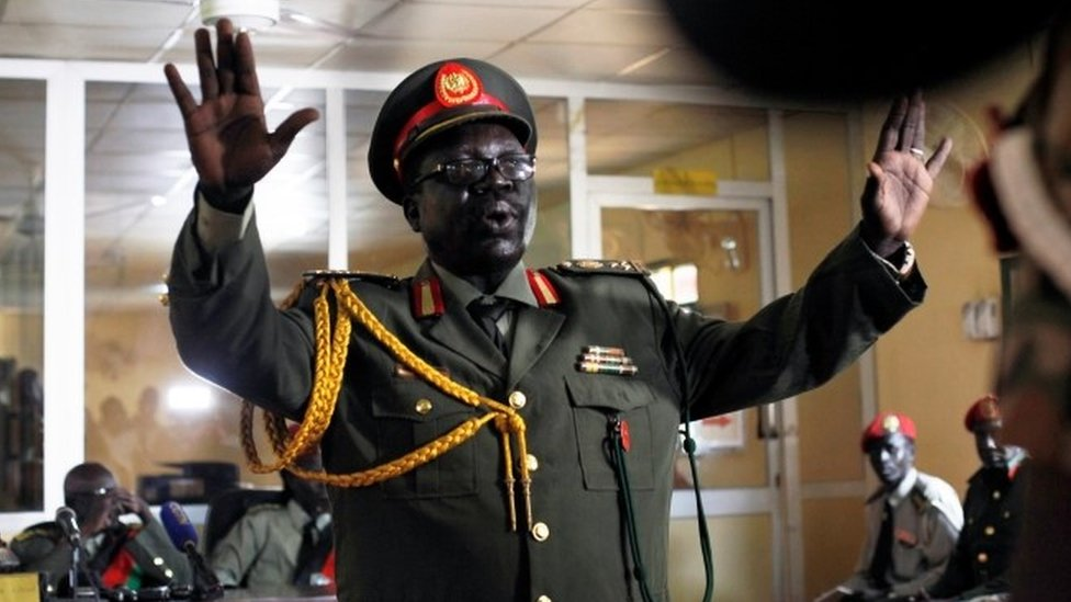 A South Sudanese military officer is seen before the hearing of 10 soldiers sentenced over the rape of foreign aid workers and the murder of a local journalist in an assault on the Terrain Hotel in the capital Juba in 2016, at a military court in Juba, South Sudan, September 6, 2018