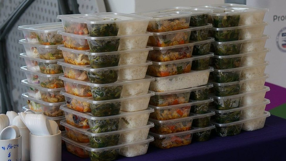 Piles of lunch boxes