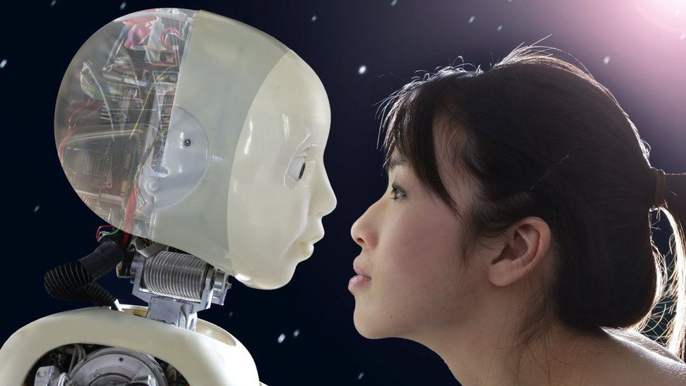 A woman staring into a robot's eyes