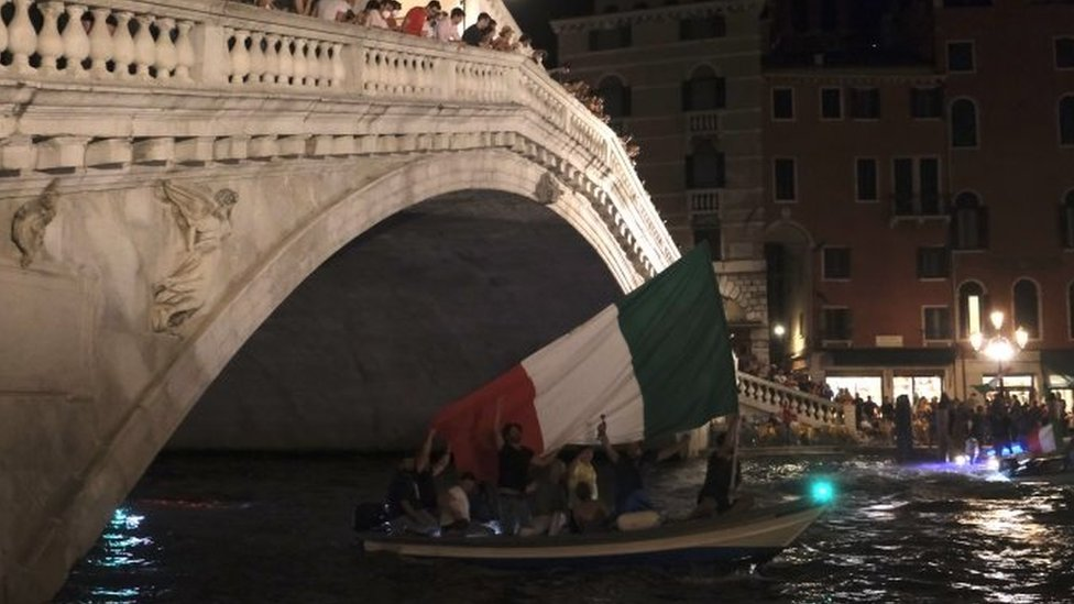 Italy fans celebrate inside a boat after winning the Euro 2020