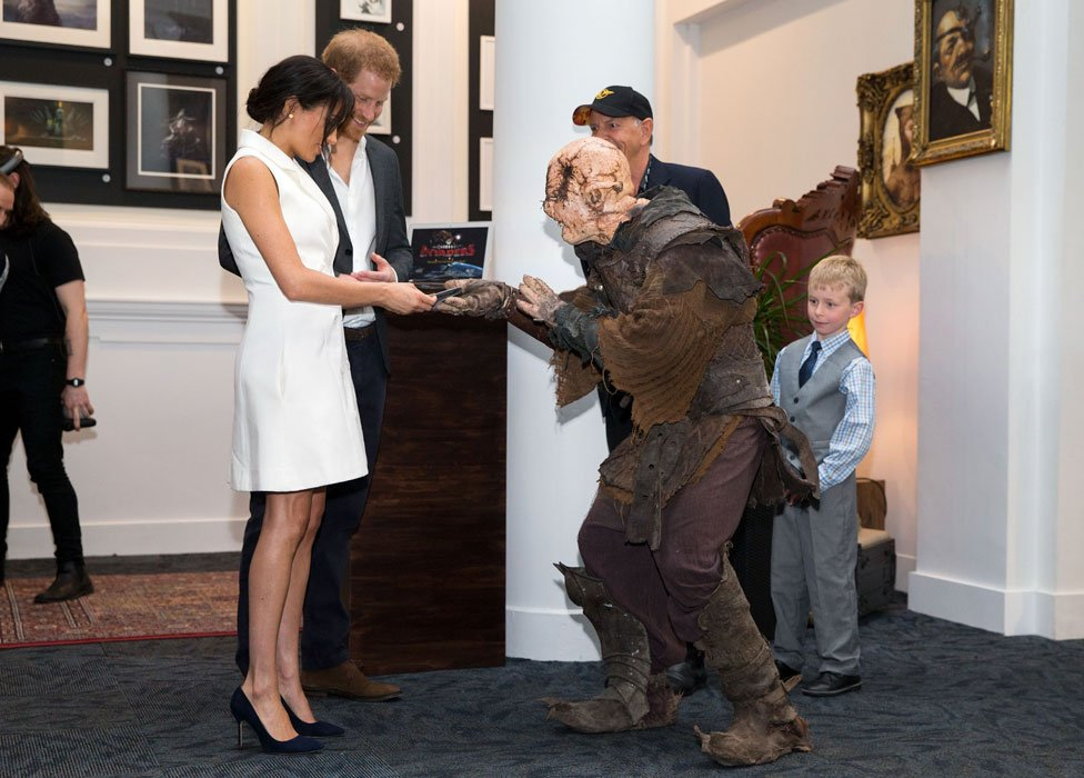 Meghan being given a gift by an orc soldier