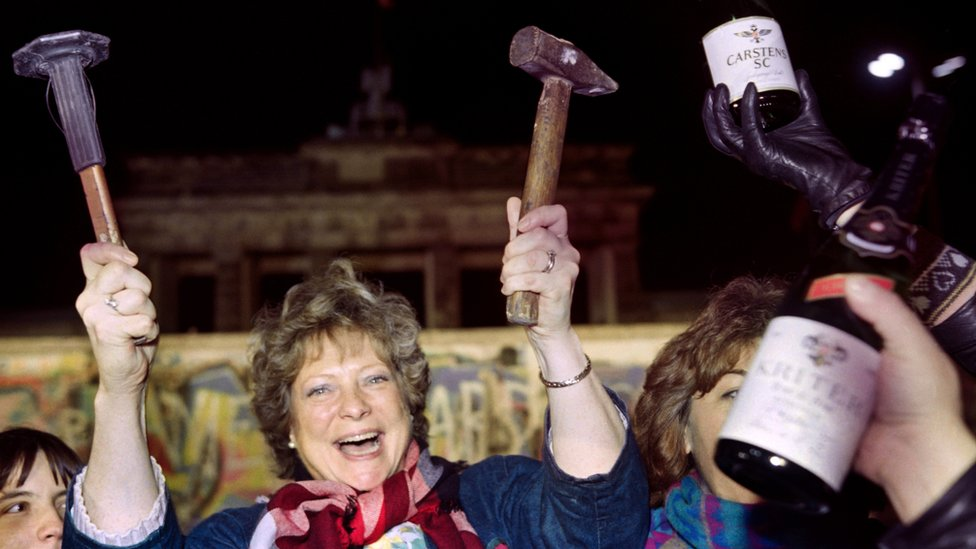 Berliners celebrate the collapse of the Berlin Wall in November 1989
