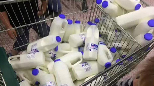 Milk cartons in a trolley