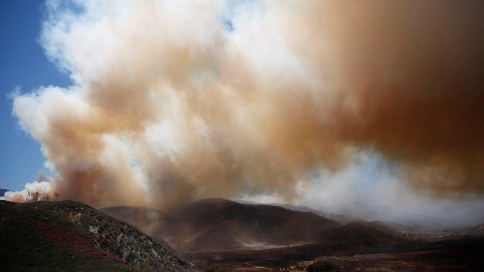Huge plume of smoke seen over charred earth