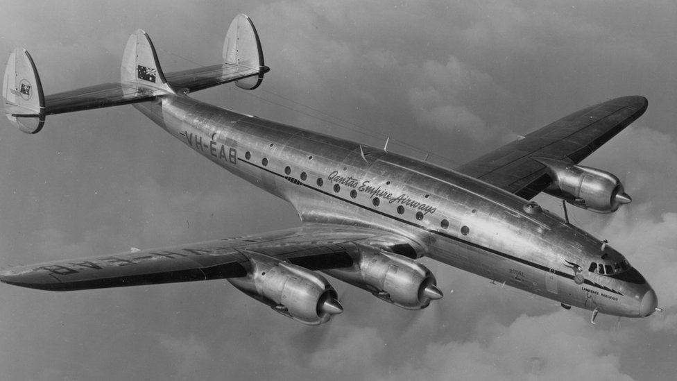 "A black-and-white photo of a Lockheed Constellation marked ""VH-EAB Qantas Empire Airways"""