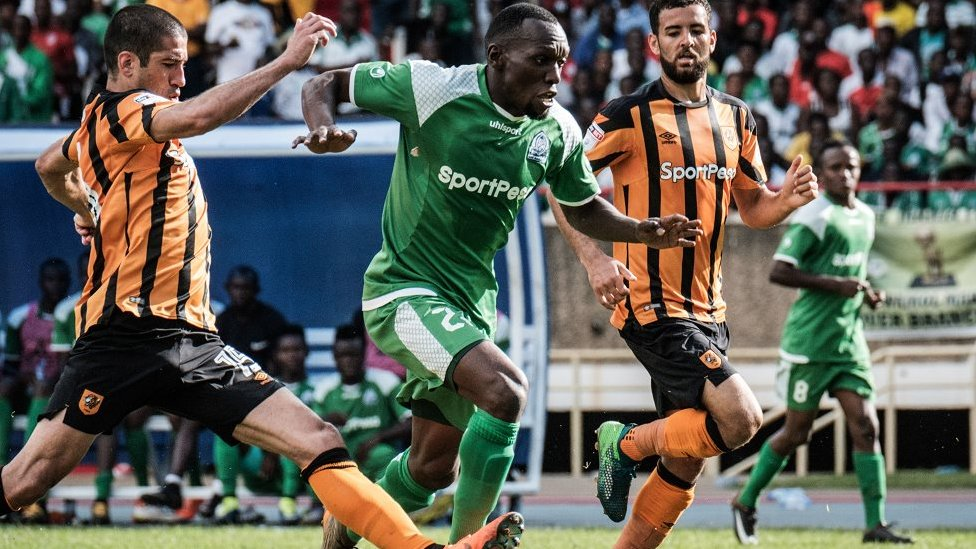 Meddie Kagere (C) of Kenyas Gor Mahia vies for the ball with Evandro Goebel (L) of Englands Hull city during their friendly match at the Kasarani stadium in Nairobi on May 13, 2018.
