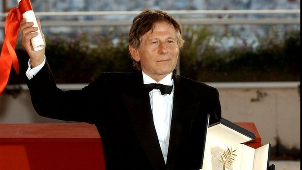 French director Roman Polanski poses with his Palme d'Or for the film The Pianist at the 55th Film Festival in Cannes, on the French Riviera, Sunday, May 26, 2002.