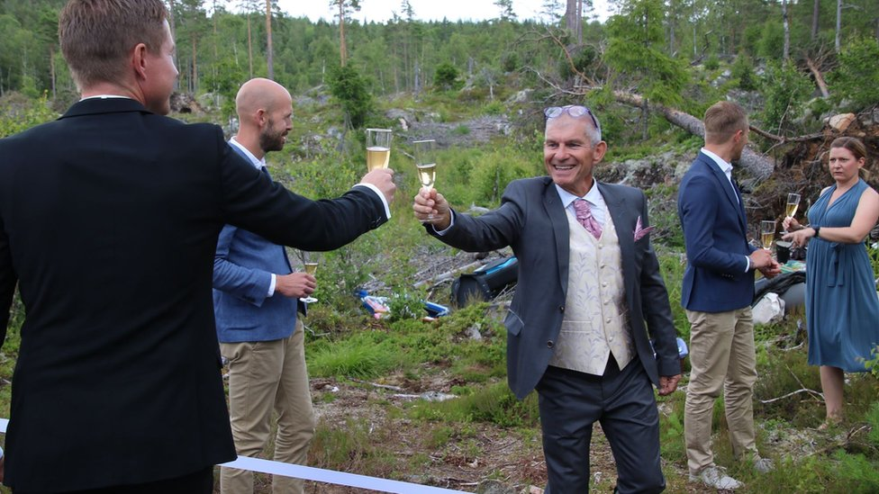 Wedding guests toast across the border
