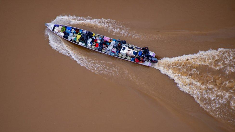Boat on the Uraricoera river carrying petrol