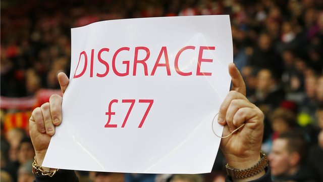 Liverpool fan holds a sign in 2-2 draw against Sunderland Anfield