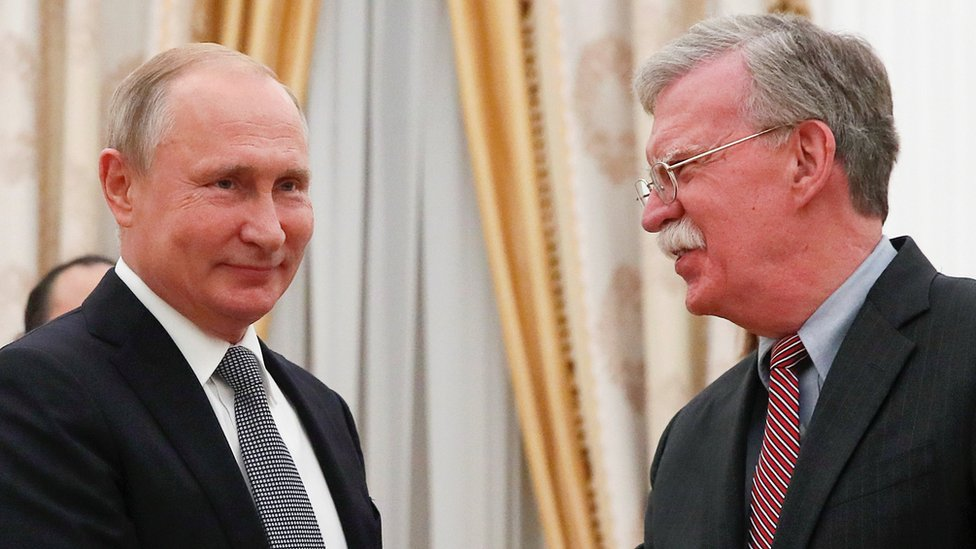 Vladimir Putin and John Bolton in Moscow in October 2018