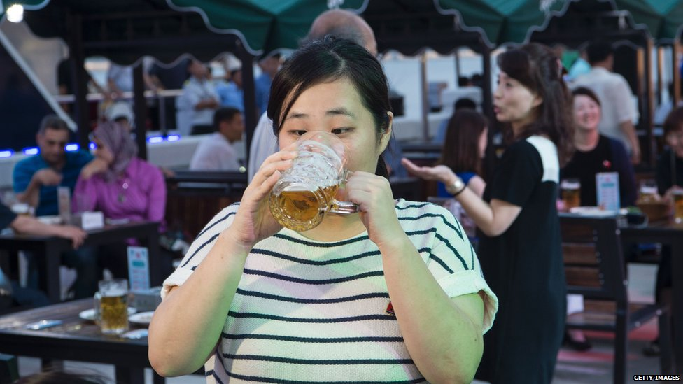 A woman drinking beer, North Korea