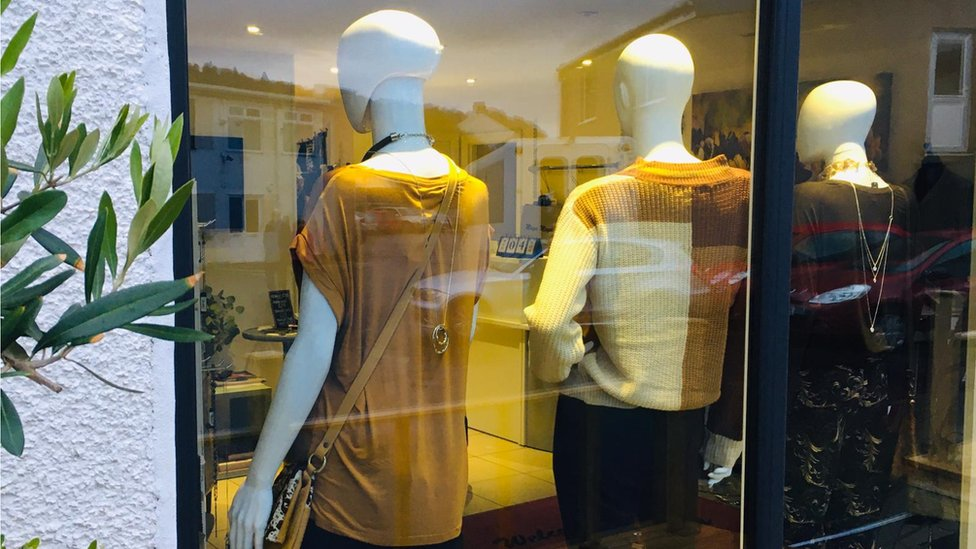 Boutique Maya Maya with mannequins with backs turned to window