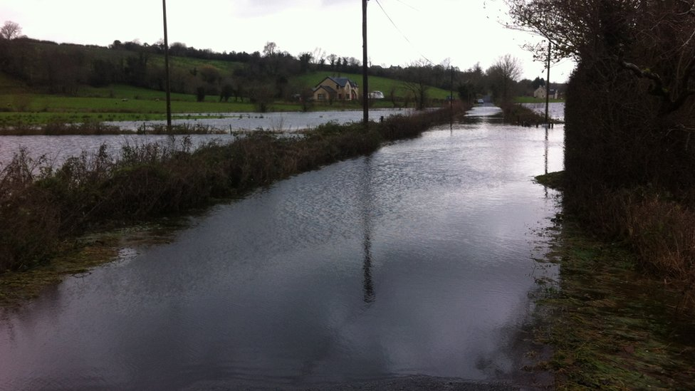A flooded road in Boho leading to Killyhommon Primary School