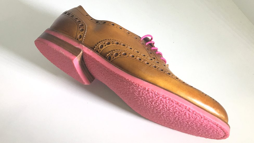 Shoe with pink sole made from chewing gum