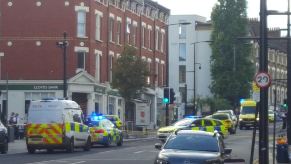 Crime scene in Sydenham Road, south-east London, after a man in his twenties was found with gunshot wounds