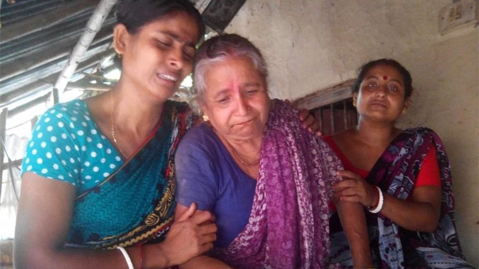 Relatives console Shefali Ganguly (C) wife of the Hindu priest Anando Gopal Ganguly (70) who has been hacked to death by suspected militants near Sonakhali canal in Jhenidah in Bangladesh 07 June 2016.